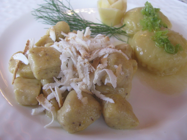 First course at the Cavallino Bianco - Hearty corn and potato dumplings topped with Trentin Grana, butter, sage and leeks